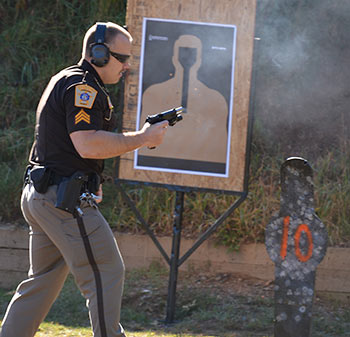 Image of an officer in gun training